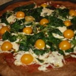 Pesto Arugula Yellow Tomato Pizza with fresh Basil