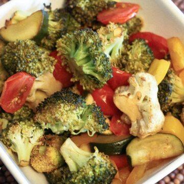 Big white bowl of roasted vegetables.