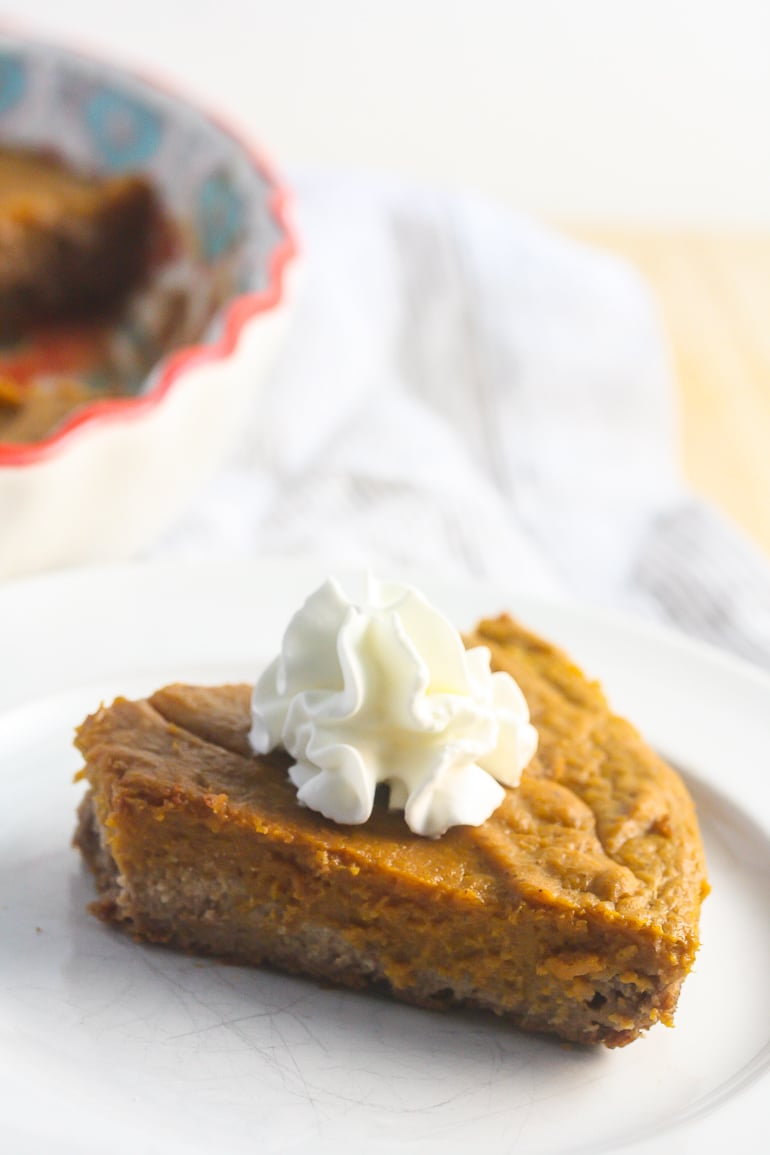 This Gluten Free Pumpkin Pie with Pecan Crust is my most requested dessert for the holidays! www.laurenkellynutrition.com