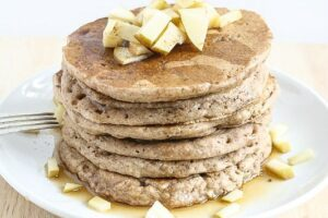 These Apple Cinnamon Pancakes are vegan, made with whole grains and no refined sugar and they are dairy-free! Everyone LOVES these!