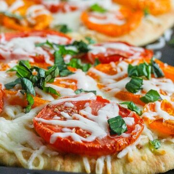 This Roasted Tomato and Basil Pizza is easy to make and delicious! www.laurenkellynutrition.com