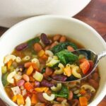 Healthy and delicious, this Easy Minestrone Soup can be made in 30 minutes! From Lauren Kelly Nutrition #vegan #AnytimePasta #Pmedia #ad