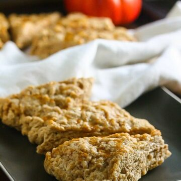 These Gluten-Free Pumpkin Spice Scones with Maple Cinnamon Glaze are the perfect way to start your day! www.laurenkellynutrition.com