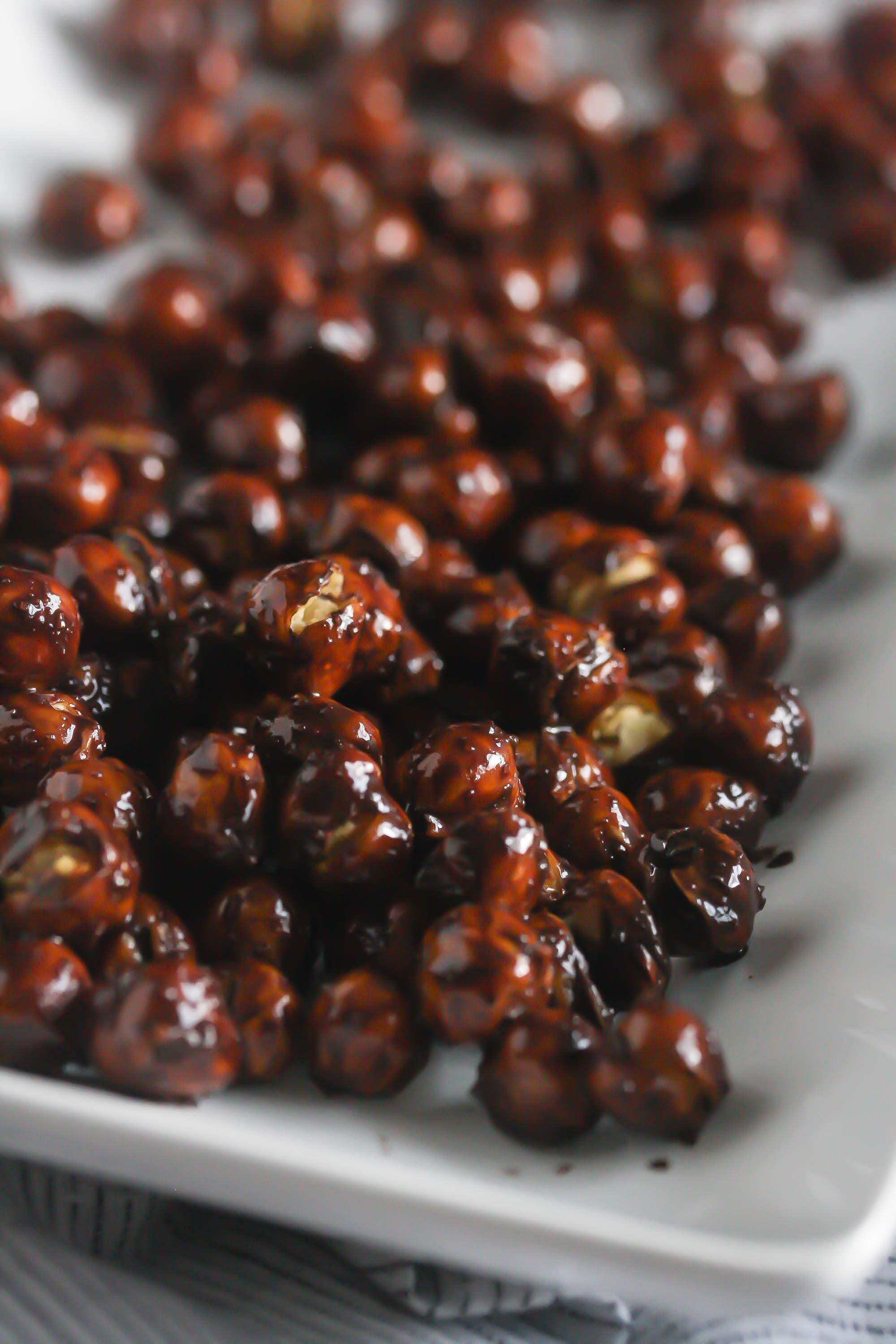 These Chocolate Covered Roasted Chickpeas are packed with protein and are crazy delicious! #vegan #glutenfree