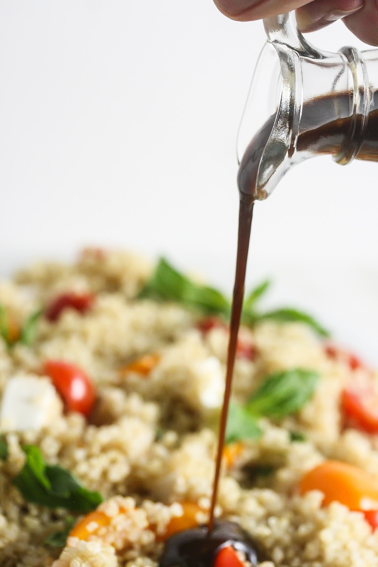 This Caprese Quinoa Salad is simple to make, healthy and delicious. Even carnivores will love this vegetarian salad. www.laurenkellynutrition.com