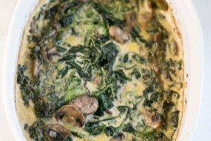 Creamy Spinach and Mushroom Gratin from The Ketogenic Kitchen Cookbook