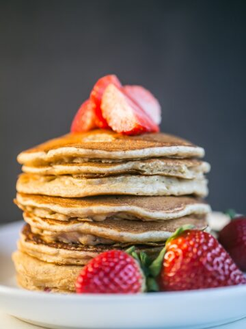#ad: Fluffy, light and delicious, these Strawberry Vanilla Pancakes can be ready in under 30 minutes! #yoplaitmorefruit @yoplait