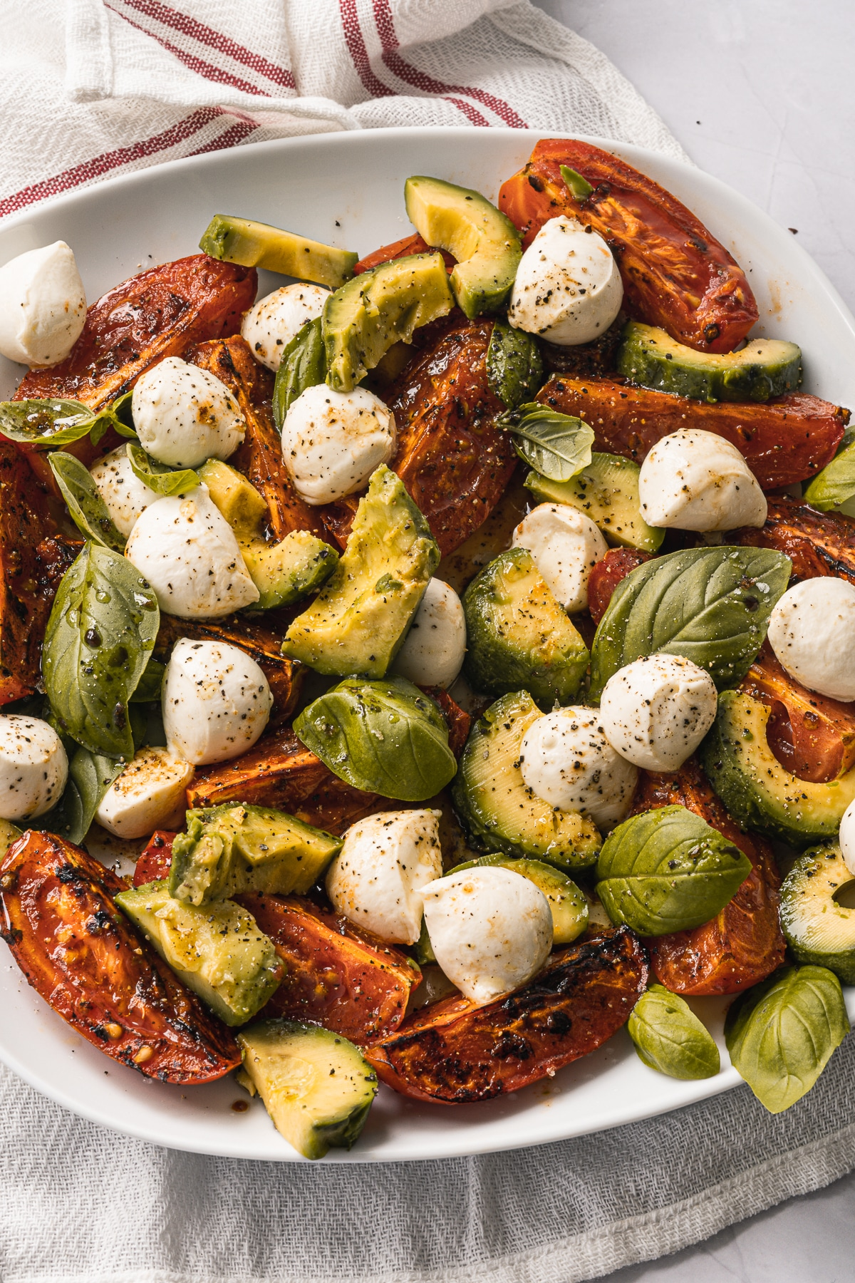 Light, healthy and ridiculously easy to make, this Roasted Tomato Caprese Salad will be your new favorite vegetarian, gluten free, low carb dish!